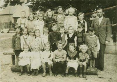 Kinder mit Lehrer